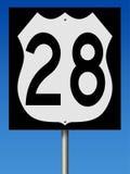 Huvudvägtecken för rutt 28 Arkivfoto