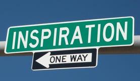 Huvudvägtecken med INSPIRATION och EN VÄG stock illustrationer