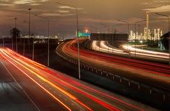 Huvudvägtrafik i solnedgång Arkivbilder