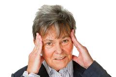 huvudvärkpensionärkvinna royaltyfri foto