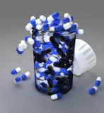 Huvudvärkstablettpreventivpillerar och flaska Royaltyfri Bild