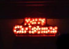 Huw Kerstmislicht Abstracte lichte tekst voor nieuw jaar stock foto