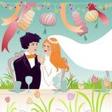 Huwelijkspaar bij feestelijke lijst Stock Afbeeldingen