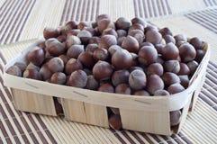 Huzelnuts in a wicker basket. Huzelnuts in a wicker basket on a table Royalty Free Stock Images