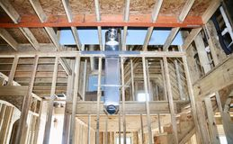 HVAC Duct for Air conditioning and heating. An open air conditioning, heating and cooling duct in the ceiling of an house under construction Stock Photos
