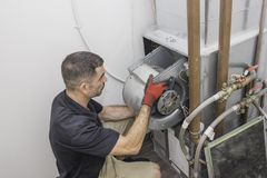 Hvac Repairman motor installation Royalty Free Stock Photos