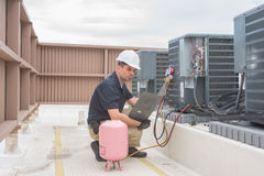 HVAC Technician with panel stock photo