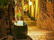 Hvar, Croatia at night. Empty stairs in alleyway of old town Hvar. Croatia illuminated at night royalty free stock photography