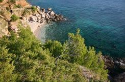 Hvar island beach - Croatia. Isolated beach surronded by pine trees facing the crystal-blue Adriatic sea Stock Photos