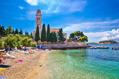 Hvar island turquoise beach and stone church Royalty Free Stock Images