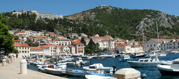 Hvar - Panorama. Large view of the touristic port and the fortress Stock Photos