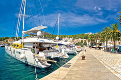 Hvar waterfront sailboat in yachting harbor Royalty Free Stock Image
