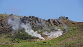 Hveragerdi reykjedalur hot steam. Hveragerdi Reykjadalur hot steam coming out mountain near the hot river royalty free stock image