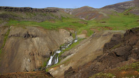 Hveragerdi reykjedalur waterfall. Hveragerdi Reykjadalur waterfall coming out mountain near the hot river stock image
