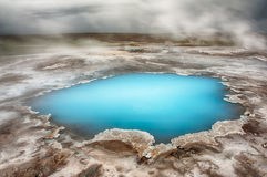 Hveravellir. Incredibly blue pool Blahver at Hveravellir is actually a hot geothermal spring in the heart of Iceland. Photo taken around midnight with a storm Royalty Free Stock Photography
