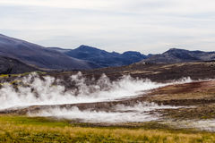 Hverir geothermal area in the north of Iceland near Lake Myvatn, with geothermal lake, looking like Blue Lagoon, Hot Mud Pots and Royalty Free Stock Photo