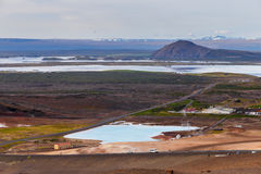 Hverir geothermal area in the north of Iceland near Lake Myvatn, with geothermal lake, looking like Blue Lagoon, Hot Mud Pots and Royalty Free Stock Photography