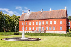 Hviderup Slott with Fountain Royalty Free Stock Photography