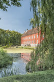 Hviderup Slott with reflection in moat. Stock Photos