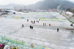 Hwacheon Ice Fishing Festival. Hwacheon , Korea-January 26 2015 : People try to fishing mountain trout on ice in Hwacheon Sancheoneo Ice Festival Royalty Free Stock Images
