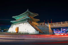 Hwaseong fortress with car light at night in Suwon. Stock Image