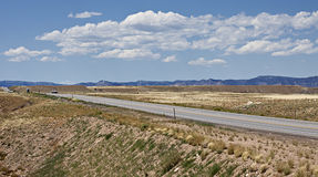 Hwy 191 through a dry Utah towards the horizon. A very unpleasant landscape that is very unforgiving Stock Photography