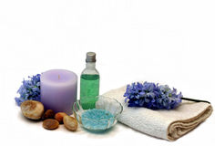 Hyacinth candle bath. Salts and shower gel in blues purples and greens Royalty Free Stock Photos