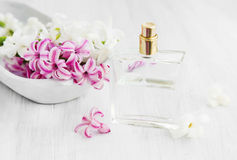 Hyacinth flowers with perfume bottle Royalty Free Stock Images