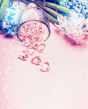 Hyacinths flowers and glass hearts on light pink background. Stock Photo