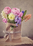 Hyacinths and ranunculus flowers Stock Photos