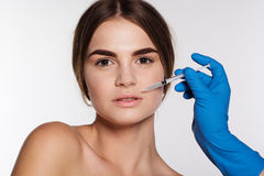 Hyaluronic acid injection for lips correction Royalty Free Stock Photo