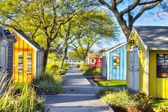 Hyannis Massachusetts Artist area sunny. Colorful small buildings making up an artist`s area near the harbor in Hyannis Massachusetts in the late afternoon sun stock image