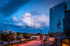 The Hyatt Regency Hotel and storm clouds over Light Street in Ba. Ltimore, Maryland stock images