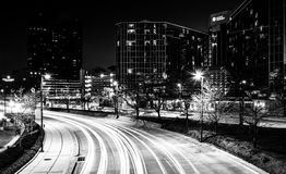 The Hyatt Regency and traffic on Light Street at night, in Balti. More, Maryland Royalty Free Stock Photos