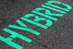 Hybrid. Parking space designated for hybrid vehicles royalty free stock photography