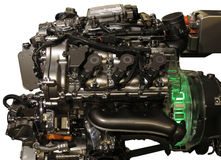 Hybrid car engine from s-class mercedes. Hybrid petrol and electric engine from Mercedes S-class car complete with electro-motor lit up in green as being in use Stock Photos