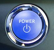 Hybrid car engine start button, automobile industry stock images