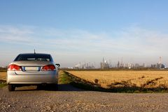 Hybrid car and refinery Royalty Free Stock Image