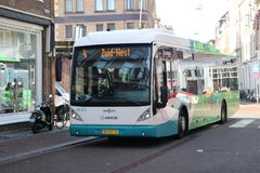 Hybrid city bus line 4 in Leiden in the Netherlands, driven by Arriva in the breestraat. Hybrid city bus line 4 in Leiden in the Netherlands, driven by Arriva stock photos