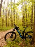 Hybrid Electric Bike with wood background. Bicycle is Cube Stereo SL140 Hybrid Electric royalty free stock photos