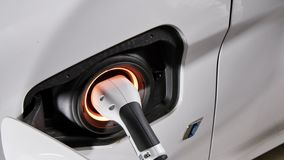 Connecting the Charger Plug of an Electric Hybrid Car stock video