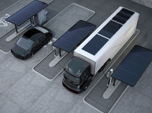 Hybrid electric truck and white electric car in charging station Royalty Free Stock Image