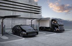 Hybrid electric truck and white electric car in charging station Stock Photo