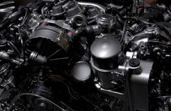 Hybrid engine mercedes dark. Hybrid petrol and electric engine from Mercedes S-class car top view, very dark image Royalty Free Stock Photos