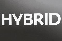HYBRID- inskrift på en grå bakgrund vektor illustrationer