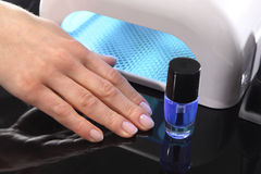 Hybrid manicure, uv lamp, nail plate curing Stock Photography