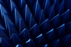 Hybrid pyramidal RF absorbers close up. Blue soft hybrid pyramidal microwave and radio frequency absorbers close up royalty free stock photo