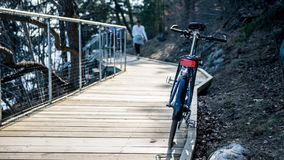 Hybrid sport street bike on wood deck by the water stock images