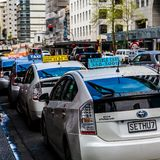 Hybrid Taxi Cabs waiting on Customs Street East stock photo