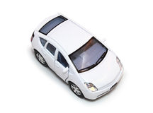 Hybrid Toy Car. Aerial view of a white, compact hybrid car isolated on white Royalty Free Stock Images